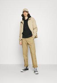 New Balance - ESSENTIALS EMBROIDERED HOODIE - Sweatshirt - black - 1