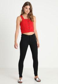 Vero Moda - VMJULIA FLEX IT MR SLIM JEGGING GU1 - Jeans Skinny Fit - black - 2
