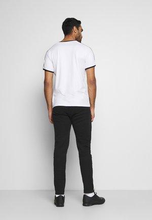 BVB BORUSSIA DORTMUND EVOSTRIPE PANTS - Teplákové kalhoty - black/castlerock
