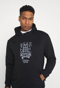 Common Kollectiv - FUTURE HOOD UNISEX  - Sweatshirt - black - 4