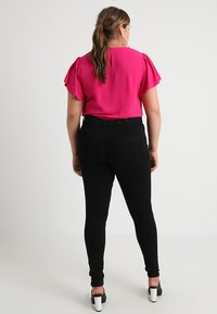 ONLY Carmakoma - CARSTORM - Jeans Skinny Fit - black - 2