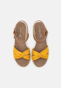 Caprice - Wedge sandals - lemon/nut - 5