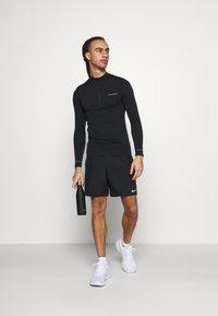 Endurance - JARO SEAMLESS MIDLAYER - T-shirt à manches longues - dark grey melange - 1