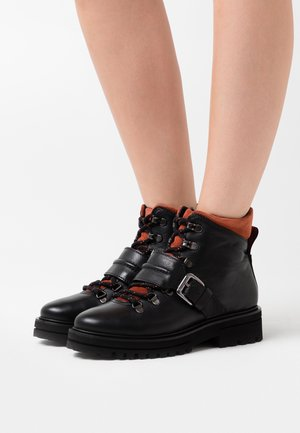 LICIA - Platform ankle boots - black
