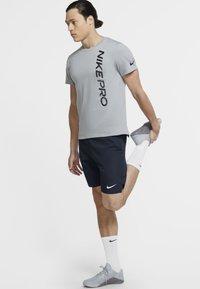 Nike Performance - FLEX SHORT - Korte sportsbukser - obsidian/white - 1