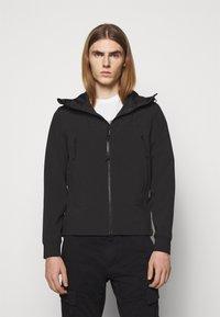 C.P. Company - OUTERWEAR  SHORT JACKET - Lehká bunda - black - 0