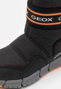 Geox - FLEXYPER BOY ABX - Winter boots - black/orange - 5