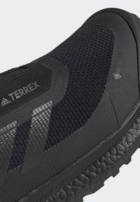 adidas Performance - TERREX BOOST COLD.RDY PRIMEKNIT HIKING SHOES - Chaussures de marche - schwarz / orange - 10