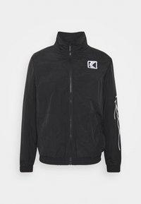 Karl Kani - SIGNATURE TRACKJACKET UNISEX - Summer jacket - black - 5