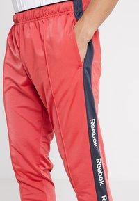 Reebok - TRAINING ESSENTIALS TRACK PANTS - Tracksuit bottoms - red - 3