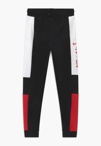 Nike Sportswear - Tracksuit bottoms - black/university red/white - 0