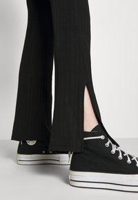 Monki - CASMIN FLARES - Trousers - black - 4