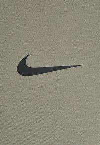 Nike Performance - DRY TANK SOLID - Sports shirt - light army/black - 2