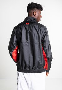 Nike Performance - Windbreaker - black/university red/chile red - 2