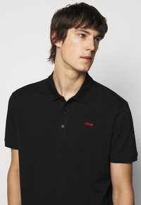 HUGO - DONOS - Polo shirt - black - 3