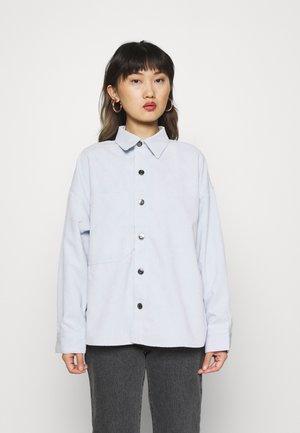 SOFIE - Button-down blouse - halogen blue
