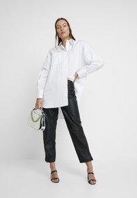 Selected Femme - SLFREJA PANT - Kožené kalhoty - black - 1