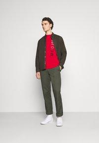 Nike Sportswear - TEE - Camiseta estampada - university red/white - 1