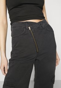 Weekday - ABEL TROUSERS - Straight leg jeans - washed black - 4