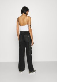 BDG Urban Outfitters - SKATE - Relaxed fit jeans - black/grey patchwork - 2