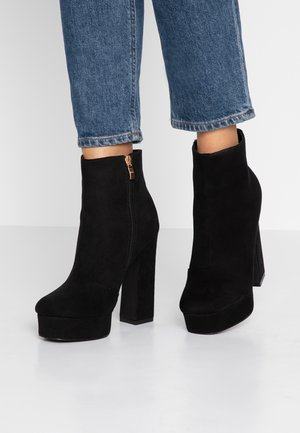 CHAYA - High heeled ankle boots - black