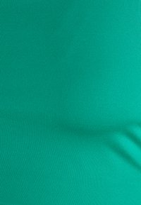Nike Performance - NON PADDED BRA - Sport-BH mit mittlerer Stützkraft - neptune green/white - 2