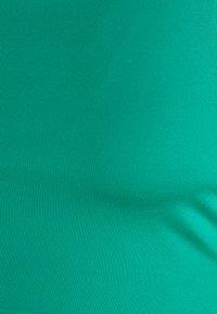 Nike Performance - NON PADDED BRA - Medium support sports bra - neptune green/white - 2