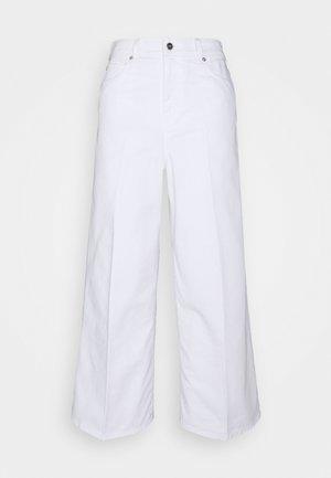 PORTLAND - Flared Jeans - white