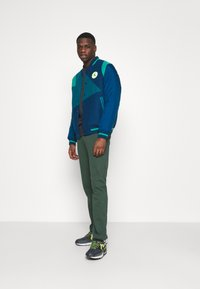 Nike Sportswear - CLUB PANT - Tracksuit bottoms - galactic jade/white - 1