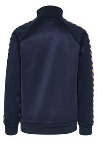 Hummel - HMLKICK - Training jacket - black iris/gold - 1