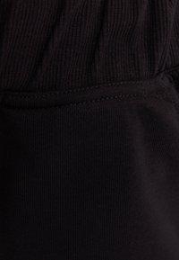 Bershka - Pantaloni sportivi - black - 5