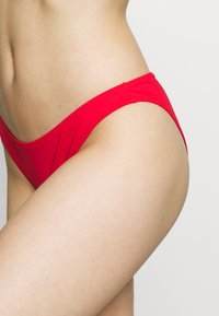 Calvin Klein Swimwear - CHEEKY - Bikini bottoms - high risk