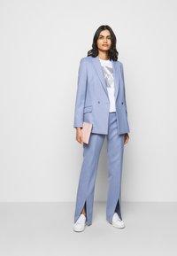 HUGO - HERLENE - Trousers - bright blue - 1