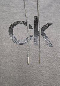 Calvin Klein - HOODED DIAMANTE DRESS - Day dress - mid grey heather - 6