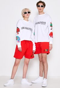 AS IF Clothing - COZY UNISEX - Tracksuit bottoms - red - 1