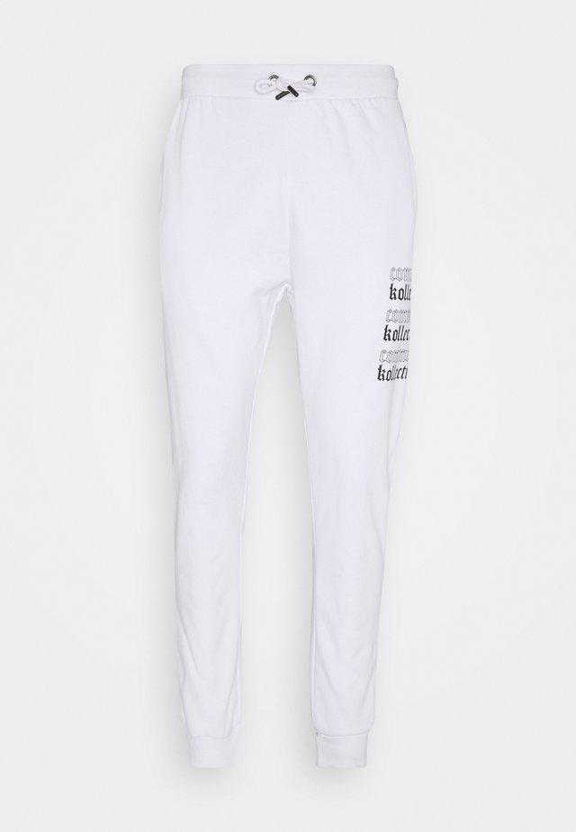 GOTHIC JOGGERS UNISEX - Tracksuit bottoms - white