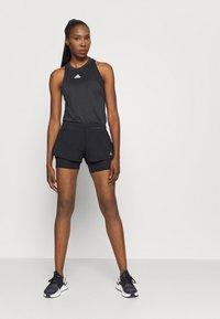 adidas Performance - TANK - Sports shirt - black - 1