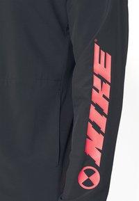 Nike Performance - Camiseta de deporte - black/white - 3