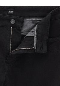 BOSS - MAINE - Straight leg jeans - black - 4
