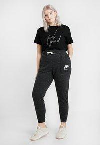 Nike Sportswear - GYM PANT PLUS - Tracksuit bottoms - black/sail - 1