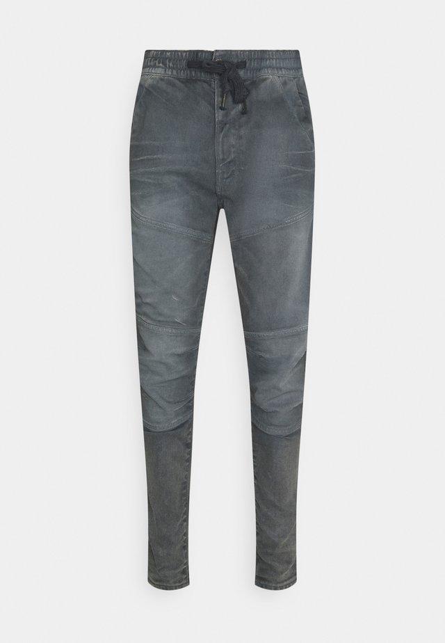 RACKAM SLIM TRAINER - Slim fit jeans - loomer grey