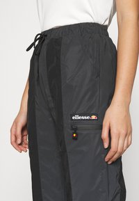 Ellesse - REFLECTIVE EQUES - Tracksuit bottoms - black - 4