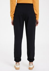 WESTMARK LONDON - Tracksuit bottoms - black