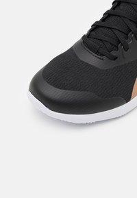 Reebok - STRIDIUM - Sportieve wandelschoenen - core black/footwear white/golden bronze - 5
