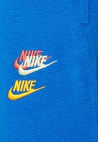 Nike Sportswear - Spodnie treningowe - signal blue - 2