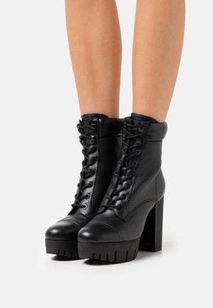 GEOVEY - Šněrovací kotníkové boty - black