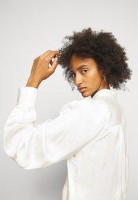 DESIGNERS REMIX - EMME SLEEVE - Button-down blouse - cream - 0