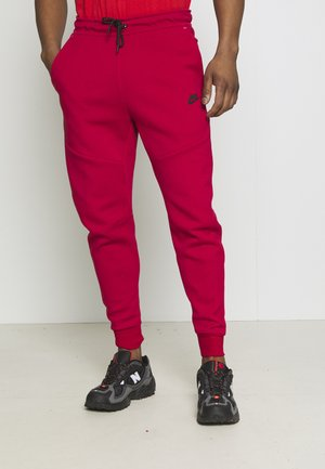 TONE - Pantalon de survêtement - gym red/fusion red