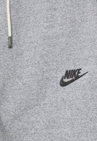 Nike Sportswear - REGRIND UNISEX - Trainingsbroek - obsidian/dark smoke grey - 2