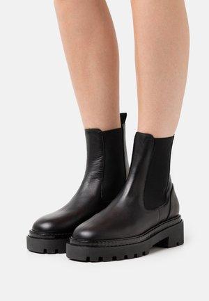 Platform ankle boots - black buttero